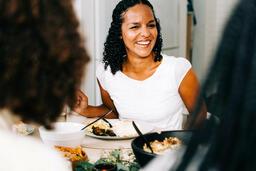 Woman Laughing and Enjoying Thanksgiving Dinner  image 2
