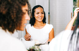 Woman Laughing with Family at the Thanksgiving Table  image 1