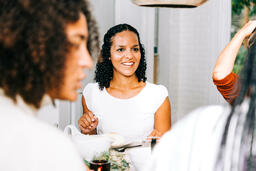 Woman Laughing with Family at the Thanksgiving Table  image 2