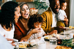 Family Laughing Together at the Thanksgiving Table  image 1