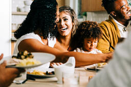 Family Laughing Together at the Thanksgiving Table  image 3