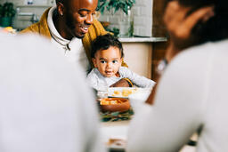 Father Holding Baby at the Thanksgiving Table  image 2