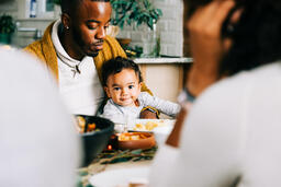 Father Holding Baby at the Thanksgiving Table  image 3