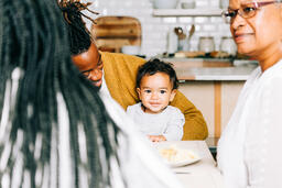 Father and Baby Interacting While Seated at the Thanksgiving Table  image 1