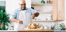 Man Carving the Thanksgiving Turkey  image 1