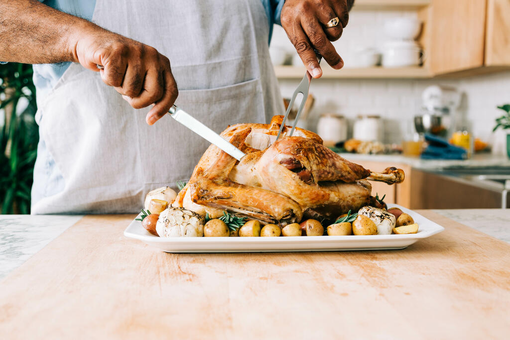 Man Carving the Thanksgiving Turkey large preview