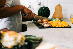 Woman Cutting Fall Vegetables  image 1