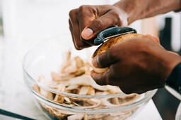 Man Peeling Potatoes  image 2