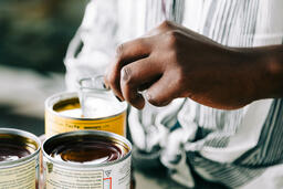 Woman Opening Up Canned Food Items  image 2