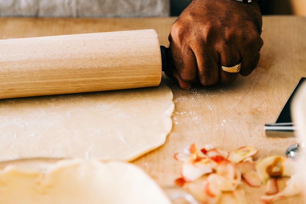 Man Baking Apple Pie large preview