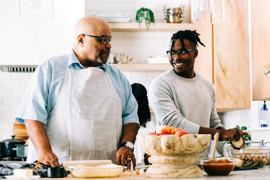 Father and Son Preparing Thanksgiving Meal Together large preview