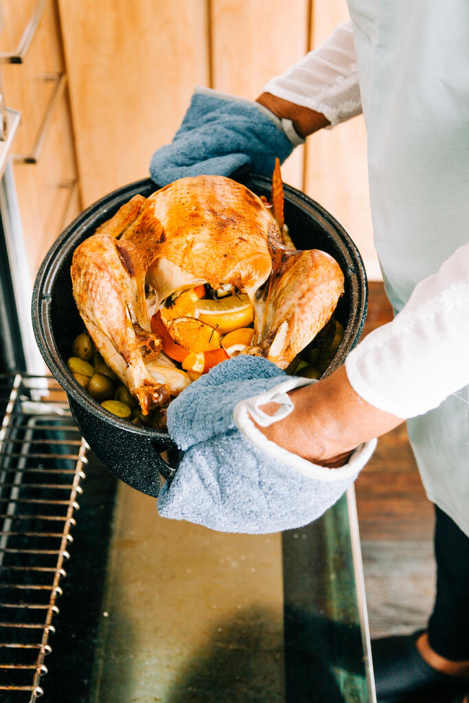 Woman Pulling Thanksgiving Turkey out of the Oven large preview