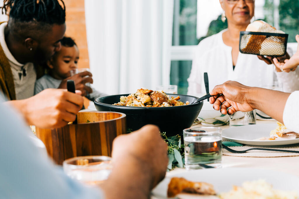 Family Serving Up Thanksgiving Dinner large preview