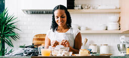 Woman Making Stuffing in Kitchen  image 1
