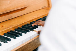 Man's Hand on Keys of Piano  image 1