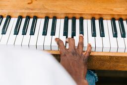 Man's Hand on Keys of Piano  image 2