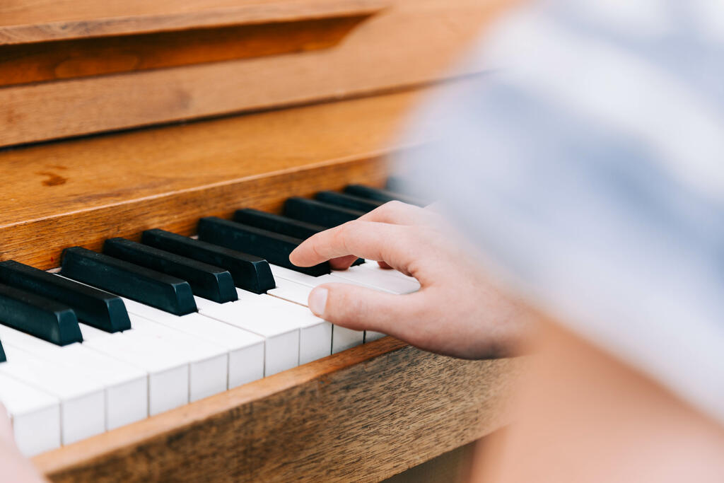 Woman's Hands on Keys of Piano large preview