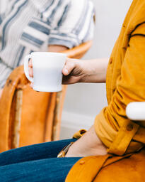 Woman Holding a Cup of Coffee during Small Group  image 3