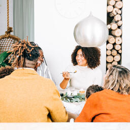 Family Enjoying Thanksgiving Dessert Together  image 7