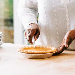 Woman Slicing Pumpkin Pie  image 2