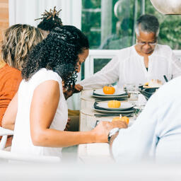Family Praying Together Before the Thanksgiving Meal  image 5