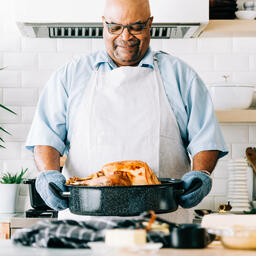 Man Holding Thanksgiving Turkey  image 2