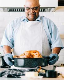Man Holding Thanksgiving Turkey  image 3