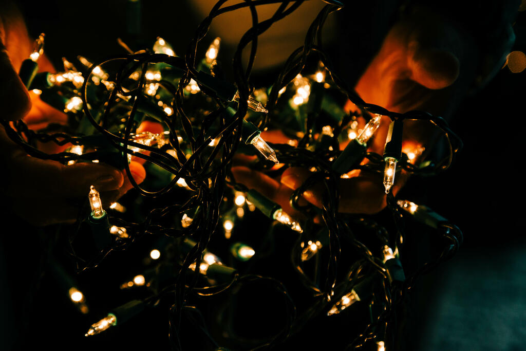 Man Holding a Bundle of Christmas Lights large preview