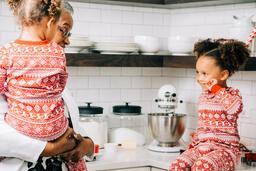 Woman Baking Christmas Cookies with her Grandchildren  image 2