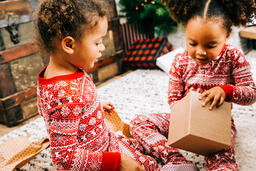 Children Opening Presents on Christmas Morning  image 2