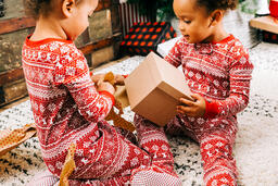 Children Opening Presents on Christmas Morning  image 3