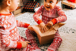 Children Opening Presents on Christmas Morning  image 1