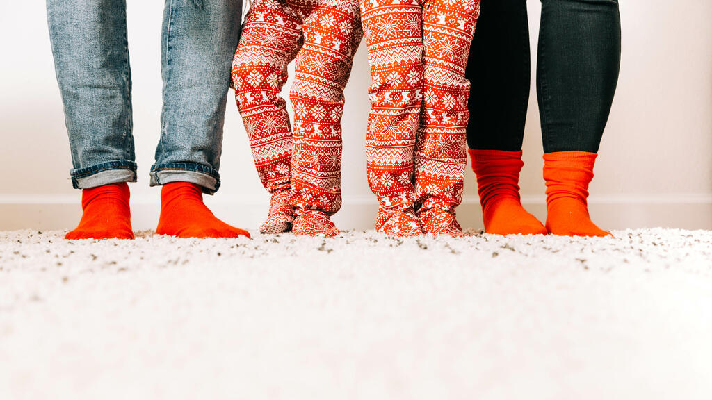 Family in Matching Christmas Socks and Pajamas large preview