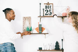 Married Couple Decorating for Christmas  image 1