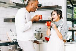 Married Couple Drinking Hot Cocoa Together  image 2
