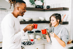 Married Couple Drinking Hot Cocoa Together  image 1