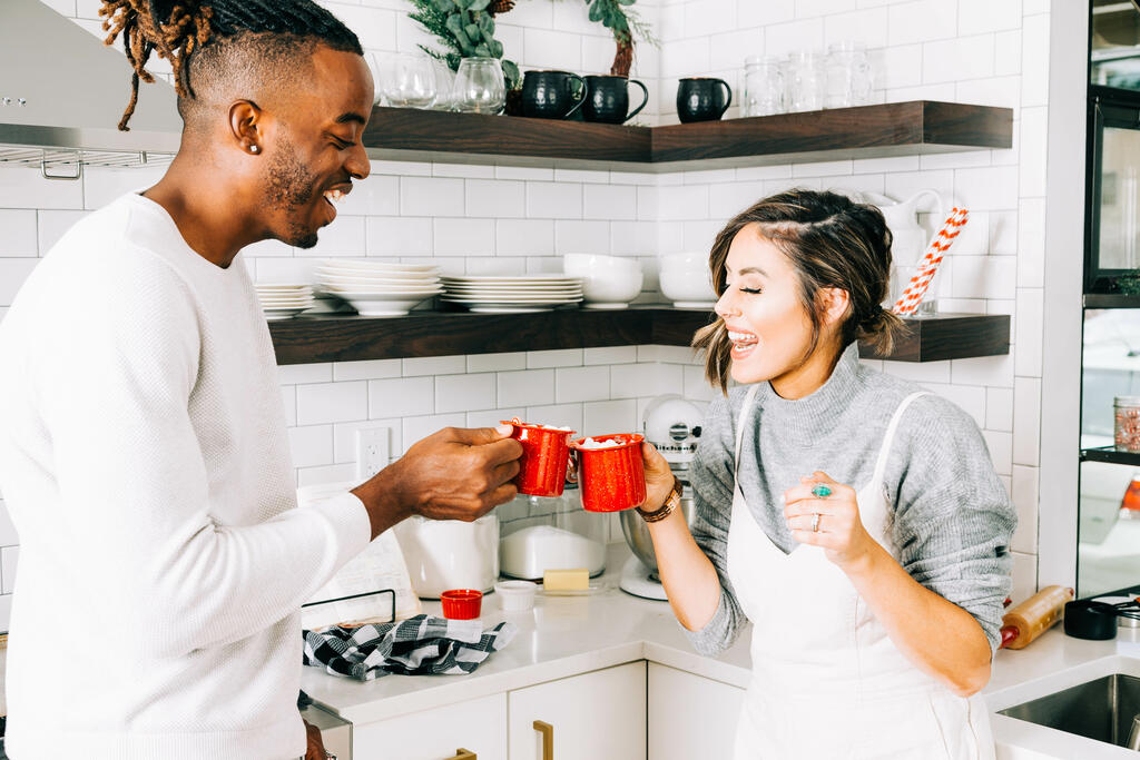 Married Couple Cheersing with Cups of Hot Cocoa large preview