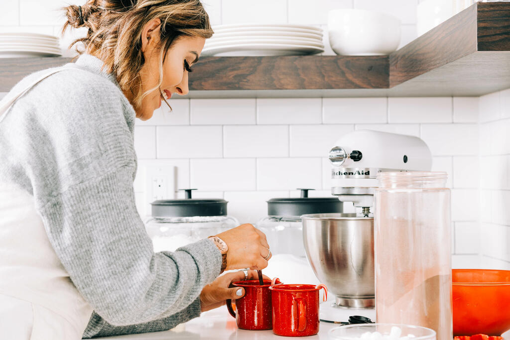 Woman Making Hot Cocoa large preview