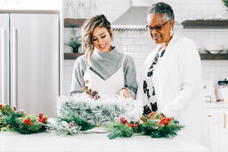 Women Making a Christmas Wreath Together  image 1