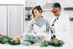 Women Making a Christmas Wreath Together  image 2