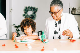 Grandmother and Grandson Doing a Christmas Craft Together  image 2
