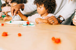 Father and Son Doing a Christmas Craft Together  image 1
