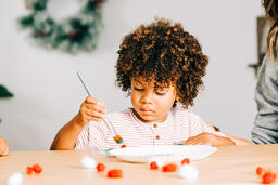 Child Doing a Christmas Craft  image 1