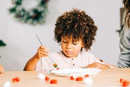 Child Doing a Christmas Craft  image 1