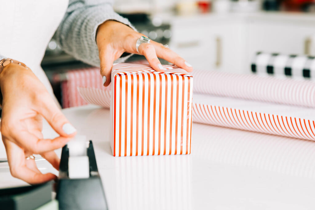 Woman Wrapping a Christmas Present large preview