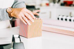 Woman Wrapping a Christmas Present  image 2