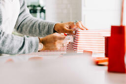 Woman Wrapping a Christmas Present  image 1