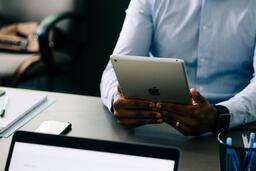 Man Using an iPad During a Meeting  image 2