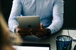 Man Using an iPad During a Meeting  image 1