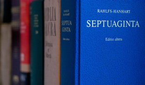 An image of the spine of several books on the Septuagint